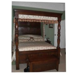 Four poster bed with full canopy.